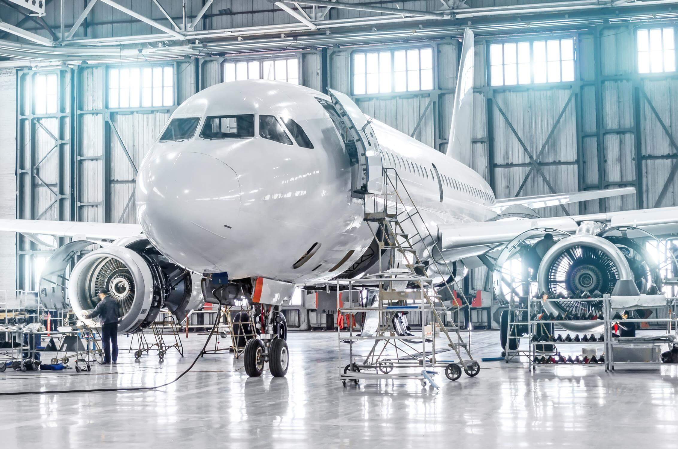 commercial jet plane in a hangar